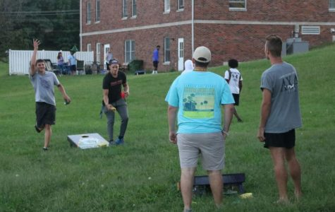 Men playing cornhole during Fraternity Rush in 2018. Photo from Megan Ferry.
